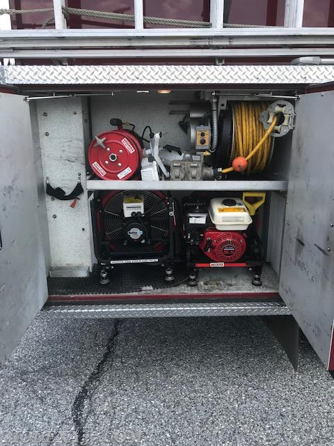 Large cord reel (yellow) stays in truck 200 ft preconnected to generator